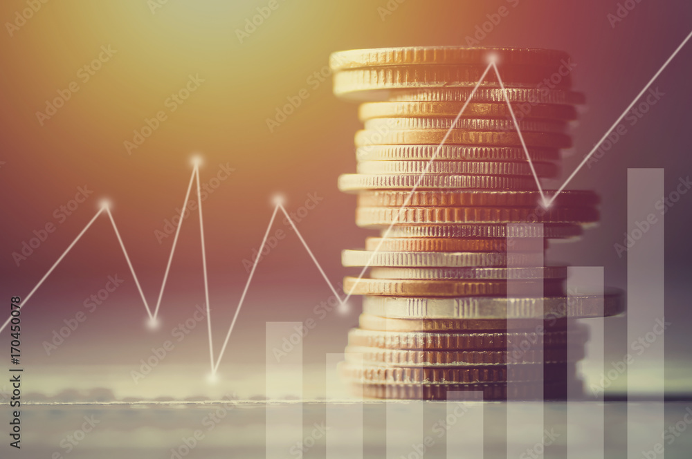 Fototapeta Stacked of coin money with account book finance and banking concept for background.concept in grow and walk step by step for success in business