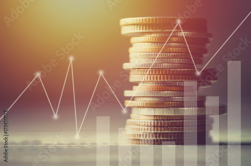 Fototapeta Stacked of coin money with account book finance and banking concept for background.concept in grow and walk step by step for success in business obraz