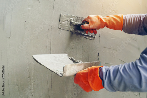 Fototapeta Hand image worker Concrete plaster obraz