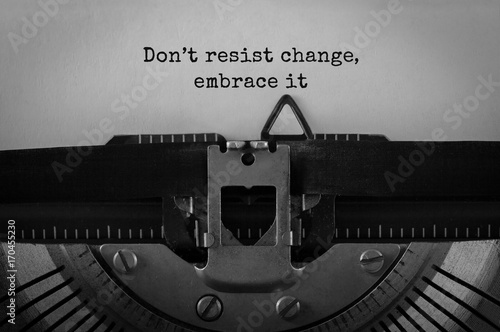Fotografie, Obraz Text Do not resist change embrace it typed on retro typewriter