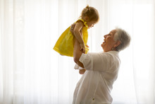 Grandmother Holding Little Gra...