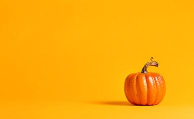 Fototapeta Halloween pumpkin decorations on a yellow-orange background