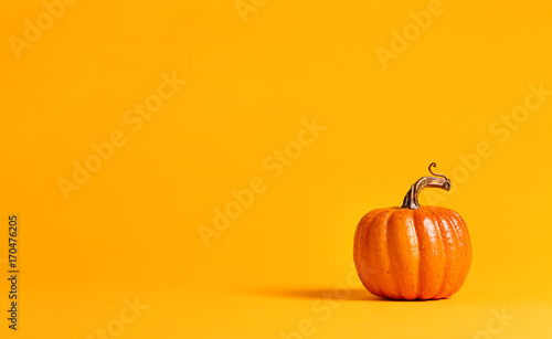 Halloween pumpkin decorations on a yellow-orange background - 170476205