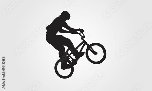 Photo Cyclist rider bmx performs trick jump logo silhouette vector