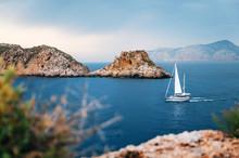 Sailboat With German Flag Are Sailing At Mediterranean Sea Between Cliffs And Rocks Against The Stormy Sky, Santa Ponsa, Mallorca, Spain