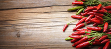 Red Chili Pepper On Wooden Bac...