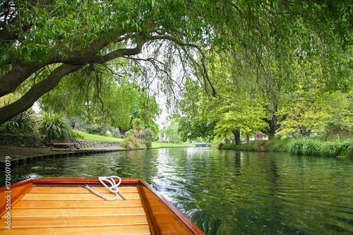 Fotografie, Obraz Punted along the River Avon in Christchurch New Zealand, under the green trees