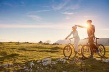 Biker Couple With Mountain Bik...