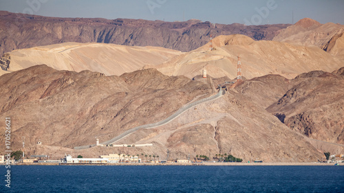 Fotobehang Midden Oosten Coastline landscape of the boarder between Egypt and Israel on the Red Sea in the Gulf of Aqaba. The fence is the boarderline. / Egypt and Israel Coastal Landscape