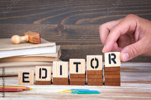 Obraz Editor concept. Wooden letters on the office desk, informative and communication background. - fototapety do salonu