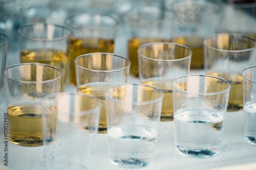 Shots lined up on plastic tray background