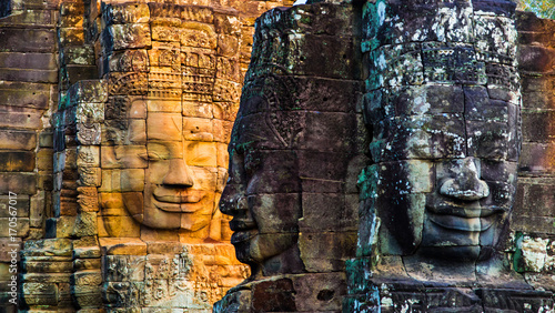 Stone murals and statue Bayon Temple Angkor Thom Wallpaper Mural