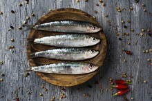 Raw Sardines On A Rustic Woode...