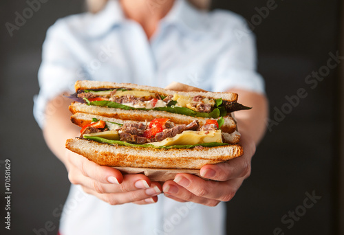 Staande foto Snack sandwich in the hands of a girl