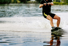 Male Wakeboarder Rides On Lake...