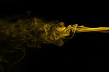 Gold Smoke On Black Background...