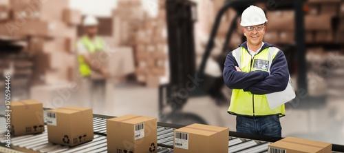 Fotografie, Obraz Composite image of worker wearing hard hat in warehouse