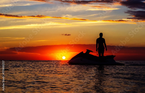 Photo Stands Water Motor sports silhouette of a man on a jet ski in the sun