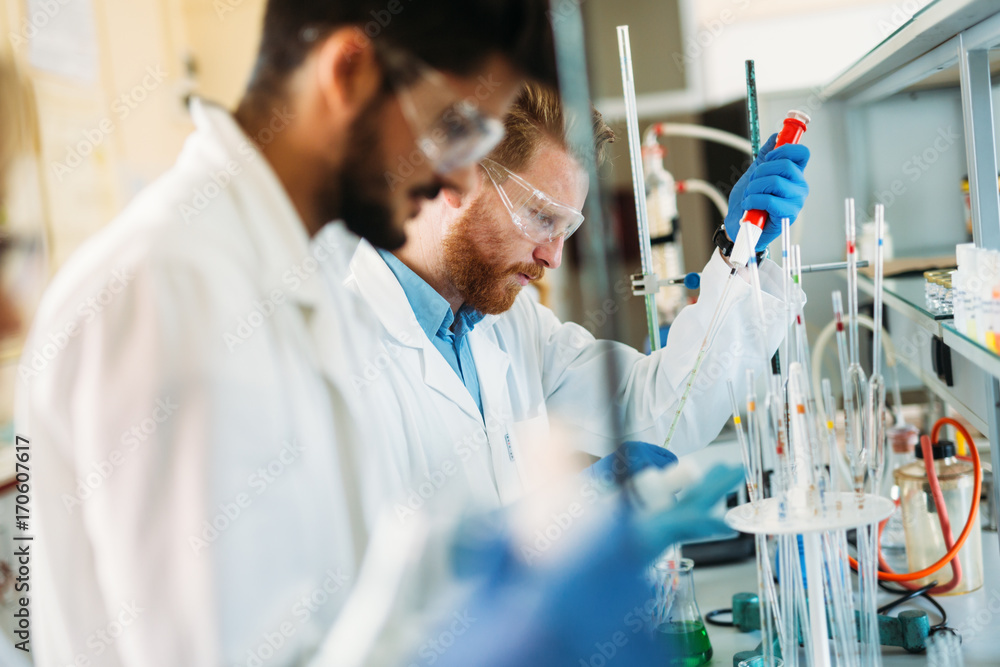 Fototapety, obrazy: Young students of chemistry working in laboratory