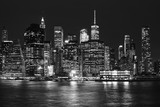 Fototapeta New York - Black and white picture of Manhattan skyline at night, New York City, USA.