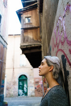 Smiling Woman In Alley