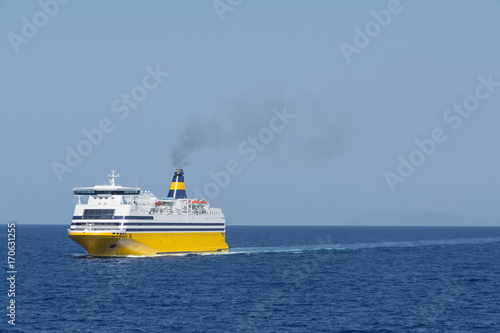 Foto view of an yellow ferry at the calm blue sea