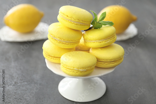 Foto op Canvas Macarons Dessert stand with tasty homemade lemon macarons on table