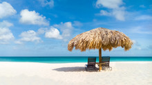 Straw Umbrella On Eagle Beach,...