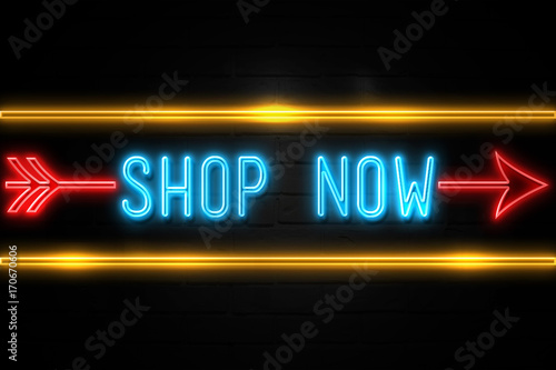 Photo  Shop Now  - fluorescent Neon Sign on brickwall Front view