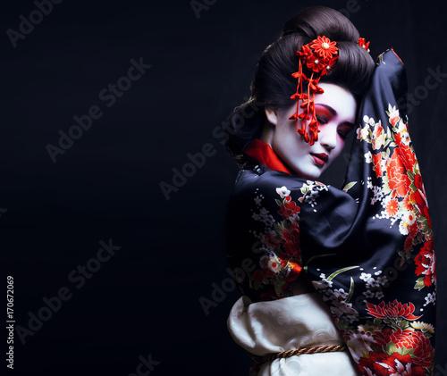 Valokuva young pretty geisha in kimono with sakura and decoration