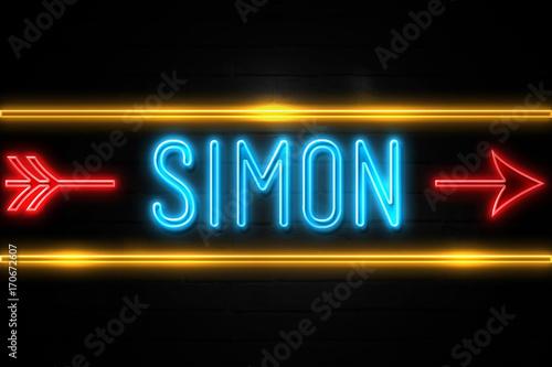 Cuadros en Lienzo Simon  - fluorescent Neon Sign on brickwall Front view