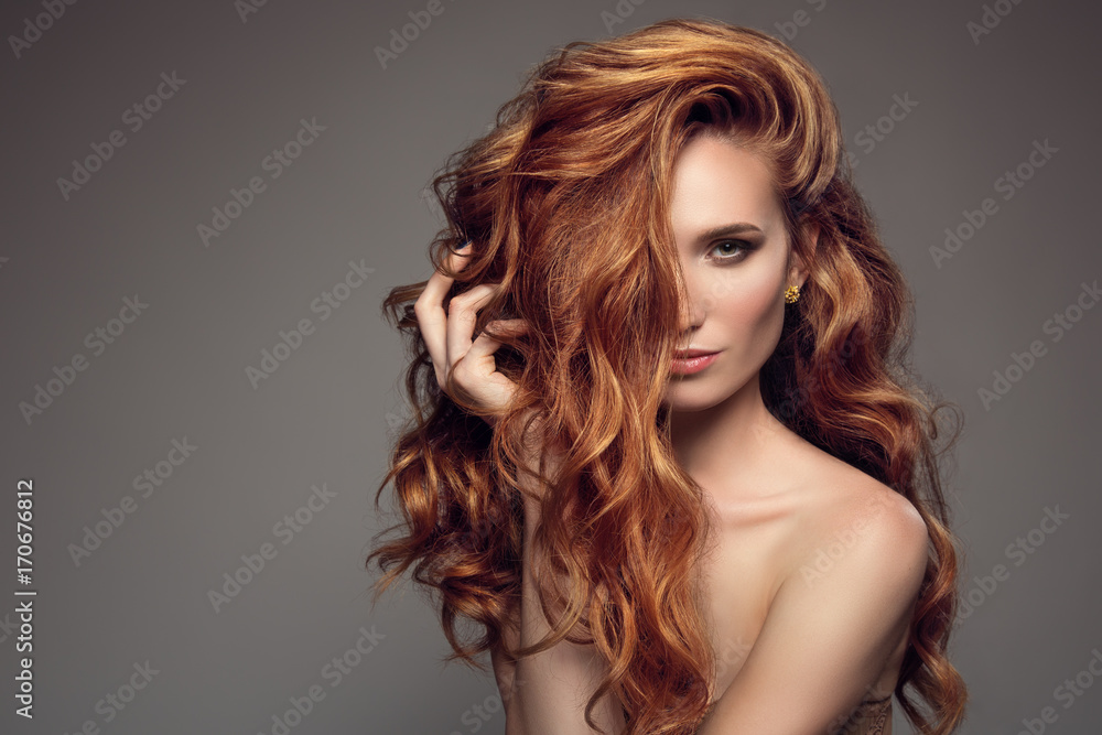Fototapeta Portrait of woman with long curly beautiful ginger hair.