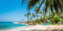 Panoramic View Of The Beach With Traditional Wooden Fishing Boats In Sri Lanka.