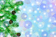 Blue Christmas background with blur and New year's with pine cones decorated with a branch of a tree