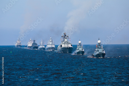 A line of modern russian military naval battleships warships in the row, norther Wallpaper Mural