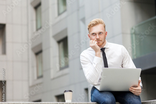 Valokuva  Young adult ginger bearded businessman , work in computer and dreaming