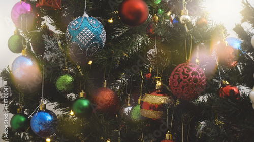 Fototapety, obrazy: Greeting Season concept.close up of ornaments on a Christmas tree with decorative light