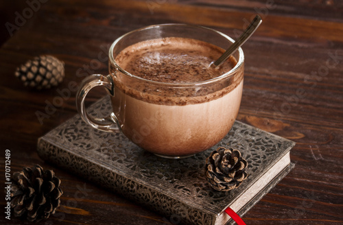 Cup Of Hot Chocolate On Notebook And Old Wooden Table With
