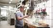 Owner making phone call in workshop