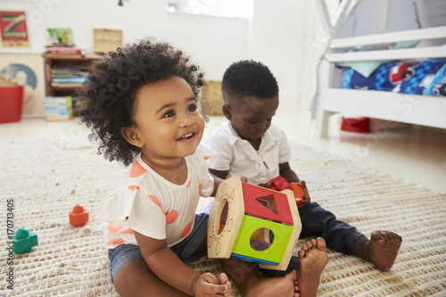 Fotografía  Baby Boy And Girl Playing With Toys In Playroom Together