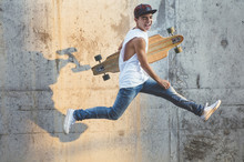 Skater Boy Jumping With Longboard.