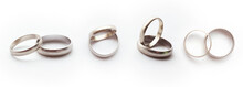 White Gold Ring Concept. Classic Wedding Rings On White Background