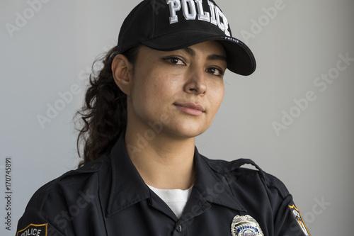 Obraz na plátně Portrait of a Hispanic female police officer