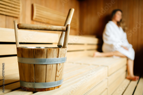 Fotografie, Obraz  Beautiful woman sitting in finnish sauna