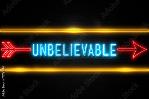 Fotografie, Obraz  Unbelievable  - fluorescent Neon Sign on brickwall Front view