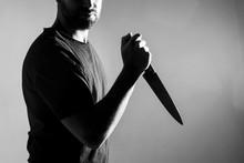 Man In Black T-shirt, Standing...