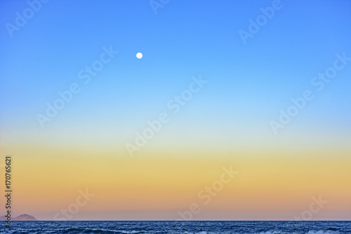 Moon over the sea during tropical summer sunset Poster