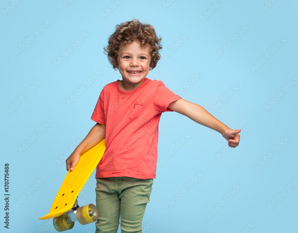 Fototapety, obrazy: Stylish boy with yellow longboard