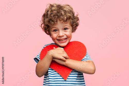 Charming boy posing with heart Fototapet