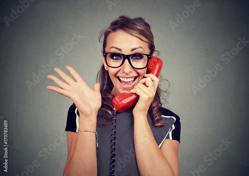 Fotografie, Obraz  Happy young woman receiving good news winning on the phone